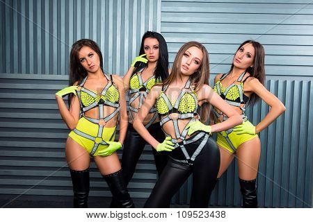 Four Confident Pretty Sexy Girls In Stage Costumes