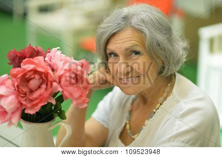 Older woman with flower