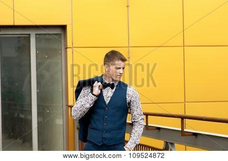 Portrait Of Handsome Man In Blue Suit.
