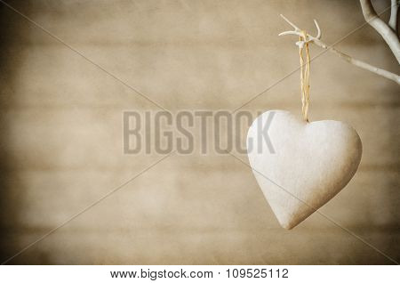 Heart Hanging From Tree On Wood Background - Vintage