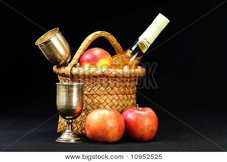 Apples,wine Glass And Bottle In The Basket On A Black  Background