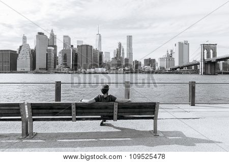 The Man Sits And Admire Of The Downtown Of New York.