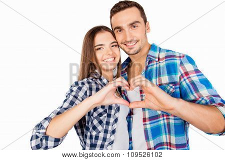 Cute Couple In Love Embracing Each Other Gesturing A Heart