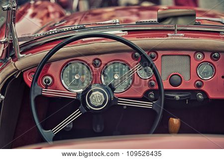 Sleza, Poland, August 15, 2015: Close Up On Vintage Car Steering Wheel And Kockpit On  Motorclassic