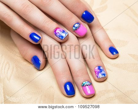 Beautiful Colorful Manicure With Bubbles And Crystals On Female Hand. Close-up.
