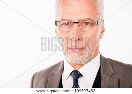 Old Handsome Businessman In An Elegant Suit With Glasses
