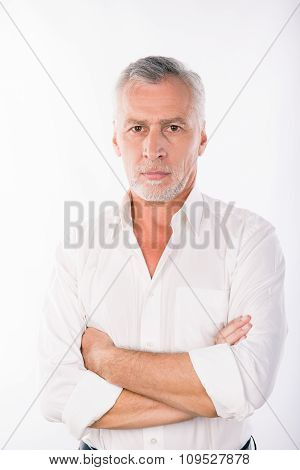 Handsome Confident Businessman With Gray Beard Crossing Hands