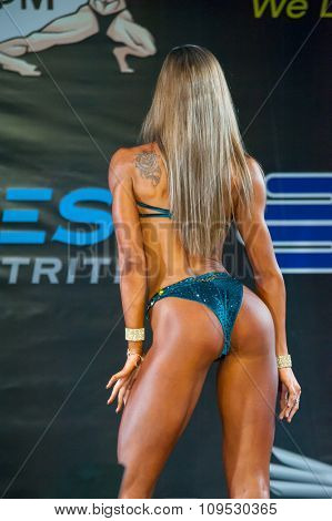 MOSCOW, RUSSIA - NOVEMBER 21, 2015: Victoria Jmoginova participates in Bodybuilding Champions Cup during SN Pro Expo Forum 2015 on November 21, 2015 in Moscow, Russia