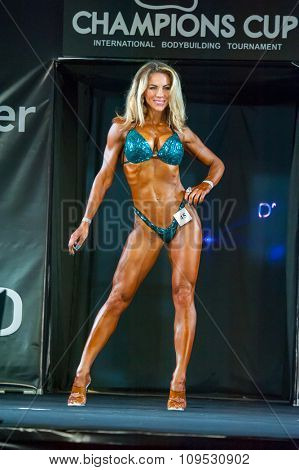 MOSCOW, RUSSIA - NOVEMBER 21, 2015: Kseniya Ponomareva participates in Bodybuilding Champions Cup during SN Pro Expo Forum 2015 on November 21, 2015 in Moscow, Russia