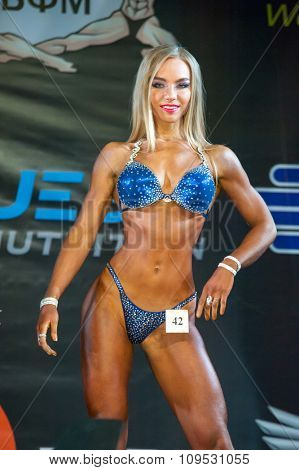 MOSCOW, RUSSIA - NOVEMBER 21, 2015: Natalia Odintsova participates in Bodybuilding Champions Cup during SN Pro Expo Forum 2015 on November 21, 2015 in Moscow, Russia
