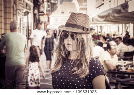 Portrait Of A Tourist Girl In A Hat