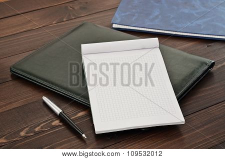 Blank Note Book And Pen On Leather Folder