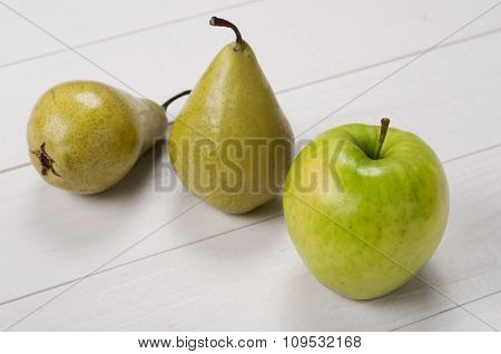 Ripe Green Apple With Pears On A White Wooden Surface