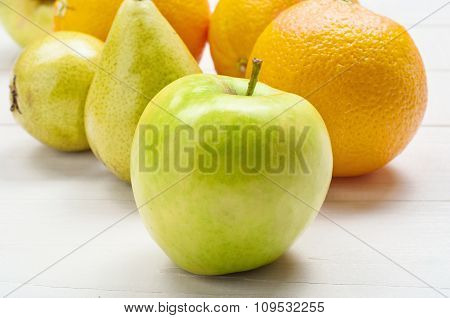 Closeup Ripe Green Apple, Oranges With Pears