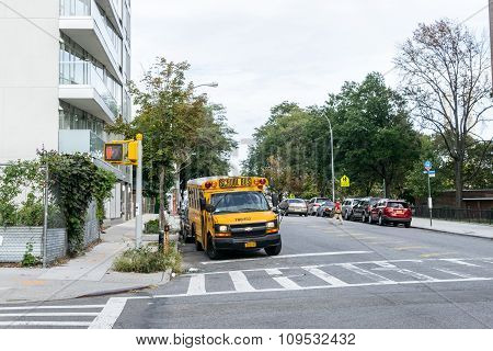 School Bus Rides Through The Streets Of Brooklyn, New York.