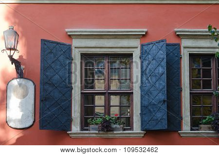 Old Wooden Windows With Metal Shutters