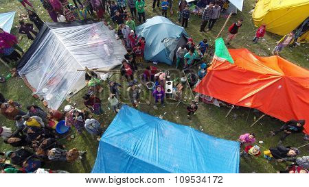 KATHMANDU, NEPAL - APRIL 27, 2015: After a magnitude 7.8 earthquake hit Nepal on April 25, people live in this makeshift camp at Taragaon park, Chuchepati. Aerial view shot with a drone.