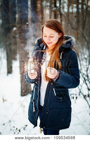 Beautiful Smiling Female Holding Sparklers