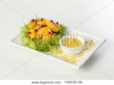 Chicken strips, lettuce and pomegranate