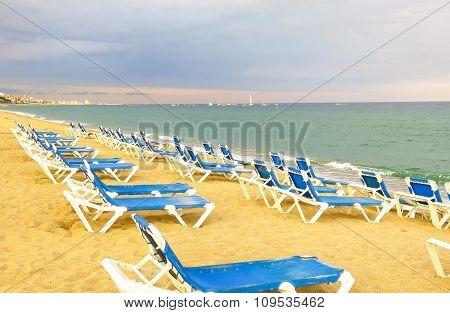 Deckchairs On A Pebbled Beach