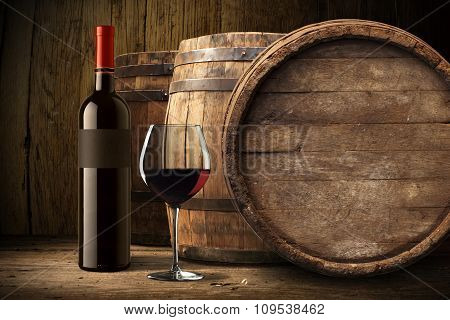 Red wine glass with bottle and barrel