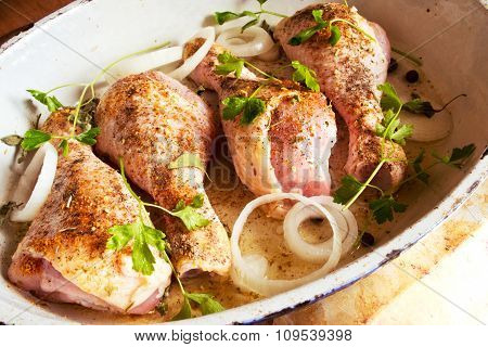 Raw chicken legs with spices