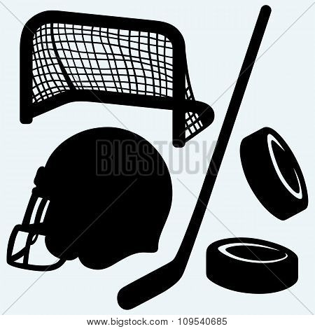 Hockey icon. stick, puck, hockey gates and helmet
