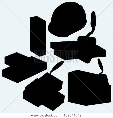Trowel, hard hat  and bricks