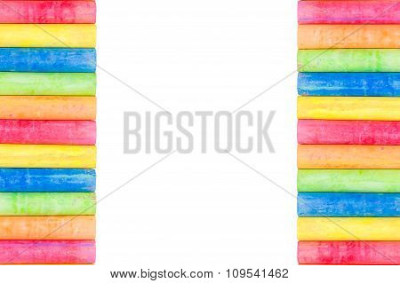 Row Of Rainbow Colored Chalk Isolate On White Background