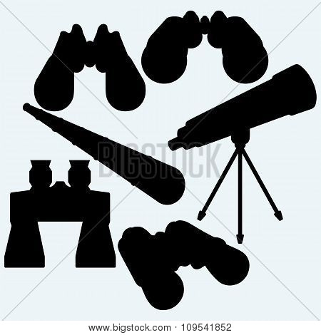 Binoculars, spyglass and telescope in tripod