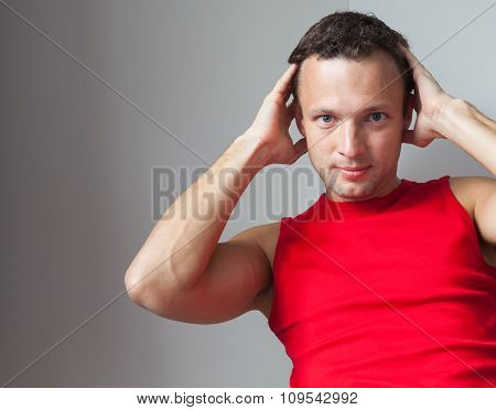 Young Caucasian Man In Red Sporty Shirt