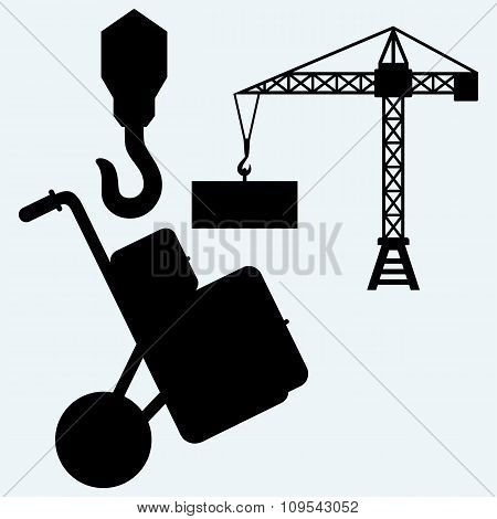 Crane working, hook of a crane and hand truck with post packages
