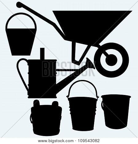 Garden wheelbarrow, watering can and buckets