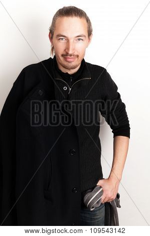 Asian Man With Black Coat And Woolen Scarf