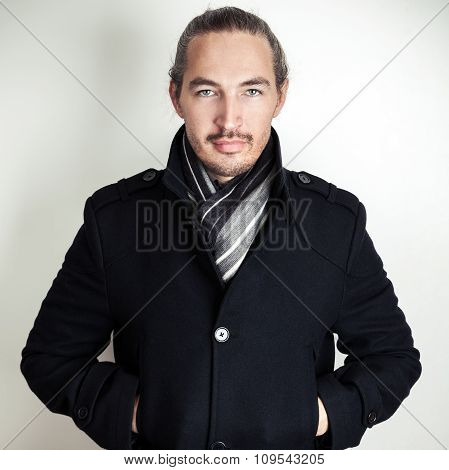 Young Asian Man In Black Coat And Woolen Scarf