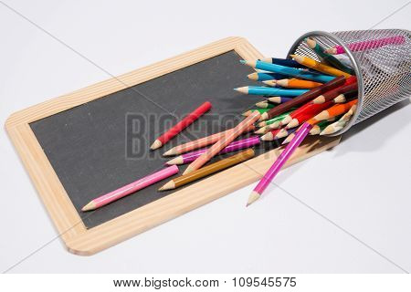 Blank Chalkboard With Multicolored Pencil Crayons - Copy Space For Message