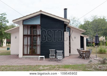 Summer Cottage Made With Wooden Piece Under Blue Sky