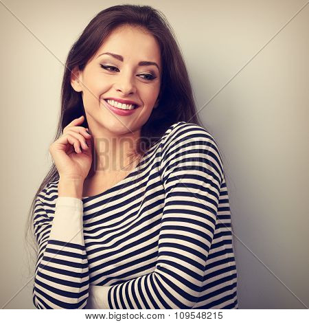 Beautiful Relaxing Thoughtful Casual Woman Looking Down With Happy Smiling