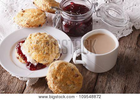 Homemade Buns With Jam And Tea With Milk Close-up. Horizontal