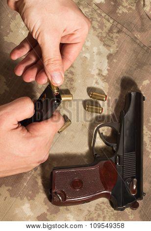 Men Load Ammo In The Clip Makarov Pistol