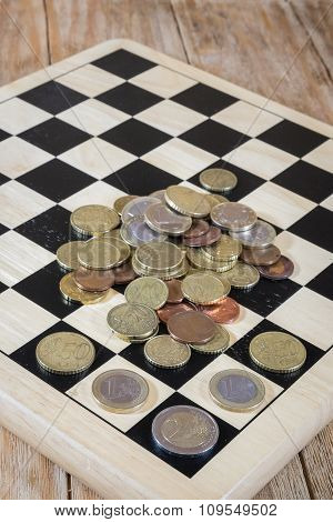 A Chessboard, Figures And Money