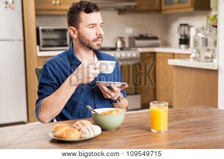 Guy Enjoying Coffee For Breakfast