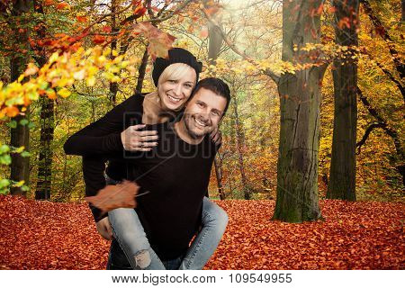 Happy young couple in autumn forrest