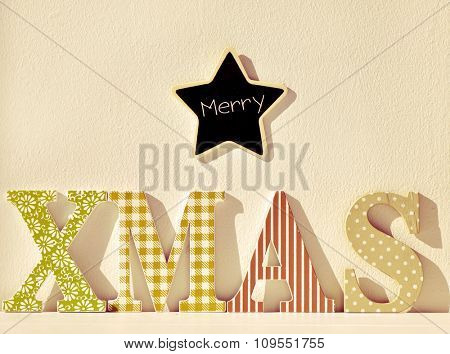 a star-shaped chalkboard with the text merry and wooden letters forming the text xmas, with a filter effect