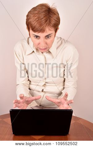 Angry businesswoman with a laptop