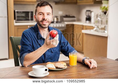 Young Man Eating Fruit At Home