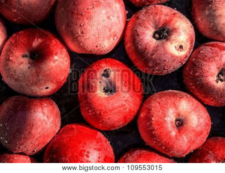 Vivid Freshly Picked Red Apples Close Up Background With Contrasting Shadows Filtered