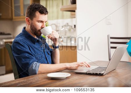 Working And Drinking Coffee At Home
