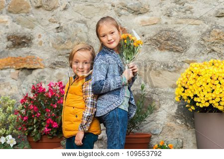Autumn portrait of two adorable kids