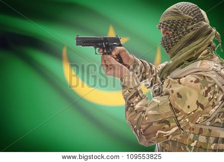 Male With Gun In Hand And National Flag On Background - Mauritania